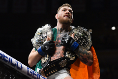 Conor McGregor hold his two championship belts after his fight against Eddie Alvarez  Photo by: Per Haljestam