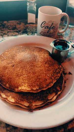 Two delicious, fresh pancakes is just one breakfast item Cafe 25:35 has to offer.  Photo taken by Kari Sundin.