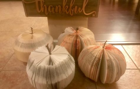 DIY Book Pumpkins stand together in their own pumpkin patch. The pumpkins were made by reusing old books from Goodwill. Photo credit to Sheri Edler.