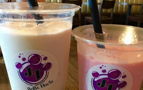 Inside JT's Boba House in Avondale, at one of the indoor tables. On the left, a snow Tiramisu-Madeleine snow mix with pineapple boba, and on the right, a Raspberry-Rose snow mix with blueberry boba. Photo taken by: Madeleine Lelito.