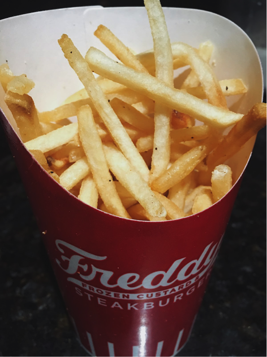"Fresh out of the box, sits Freddy's fresh cut fries. ""The seasoning tastes like no other fry,"" Sophomore, Michael Chestnut said."" Photo by: Jordan Argano"
