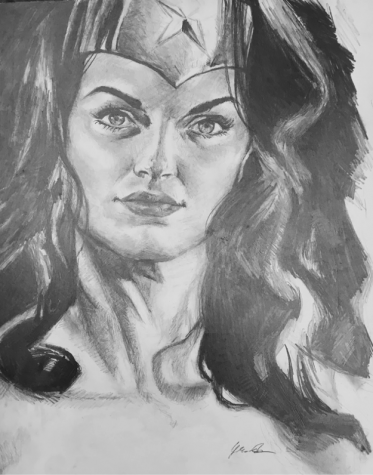 A graphite drawing on paper of Wonder Woman from the Justice League movie. In this piece you can see the use of different graphite techniques such as smudging and gradients from a light value to a darker value to represent shading and the illusion of light. Drawing by Jessie Siemens. Photo by Madeleine Lelito.