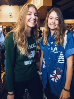 "Jolie Eaton and Mya Lussier strutting their ""ugly"" Christmas attire. They are starting the week off strong as they prepare for the rest of this week's festivities. Photo by Jordan Argano."