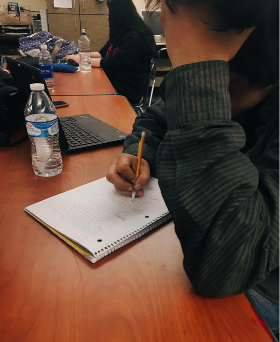 Most students review their notes from the semester to refresh their memory before finals. Senior Orlando Rivas studies his literature notes for his upcoming test. Photo credit goes to Hannah Shelton.