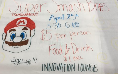 A student made poster advertises the upcoming Super Smash Bros. Tournament. The tournament was planned by the National Honor Society as a fundraiser. The poster was made by NHS President Naomi Kharrl and Krysyan Edler.