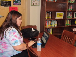 Sophomore Marisa Tapia working on academics in the Verrado High School library.