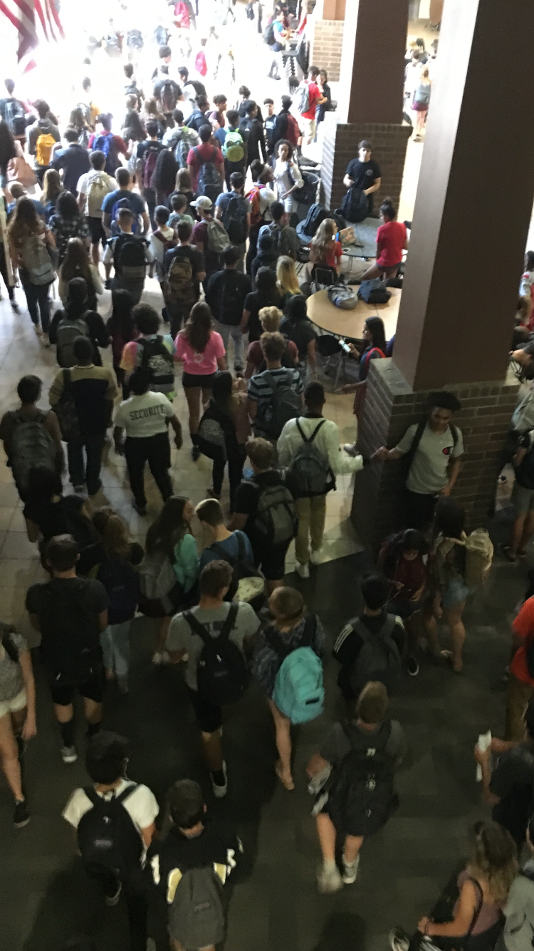 Student foot traffic in Verrado High School's halls at the end of a school day.