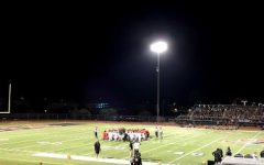 Sep. 5: Verrado and Williams Field football players take a knee in the center of the field after a player injury