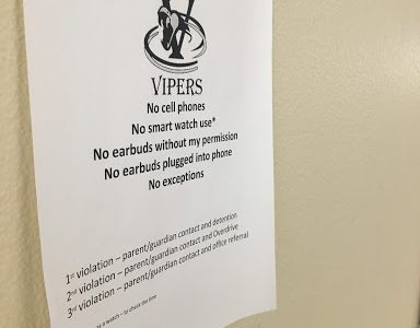 Posters around Verrado High, like the one above, inform students about the school's new OverDrive policy.