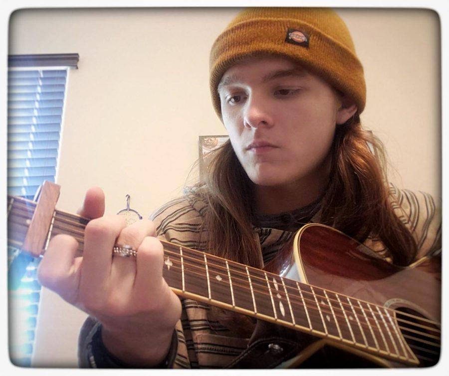 Caleb playing Guitar
